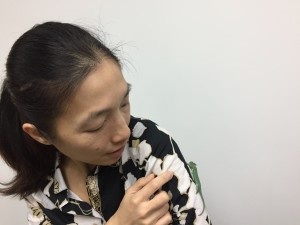 Woman holding a chameleon for the first time